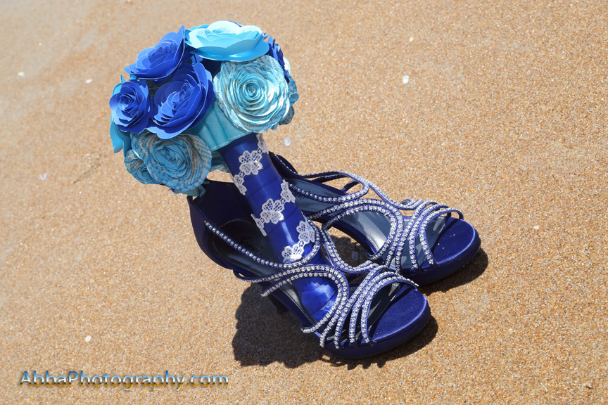 Blue wedding shoes in the sand